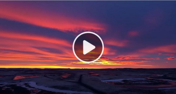 Screenshot of Seven Generations video. Image of a sunset.