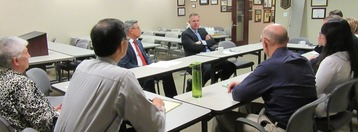 Photo: Congressman Scott Peters visiting with SBA staff members.