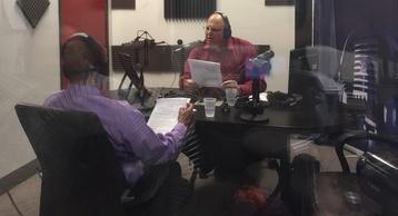 Photo: Carlos Figari hosting SBA Radio at wsradio studio