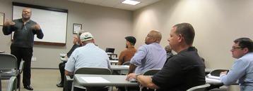 Photo: Tony Wilkins presenting a workshop