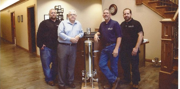 Ken Bellesine (2nd from left) and family at CELCO, Inc.
