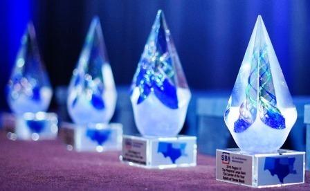 Photo of lender award trophies