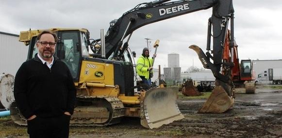 Mike Nieto next to construction equipment
