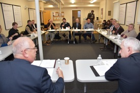 District Director, Mark S. Hayward and Senator Jack Reed speak to veterans about doing businesses in Rhode Island.