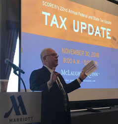 Mark S. Hayward gives opening remarks at SCORE's tax seminar.