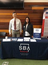 Photo: Lead BOS, Carlos Liu and BOS, Merica Le working SBA's booth during networking session.