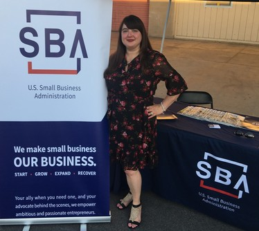 Photo of Jamye Pritchett Solorzano working an SBA exhibit booth at a Brawley Chamber outreach event