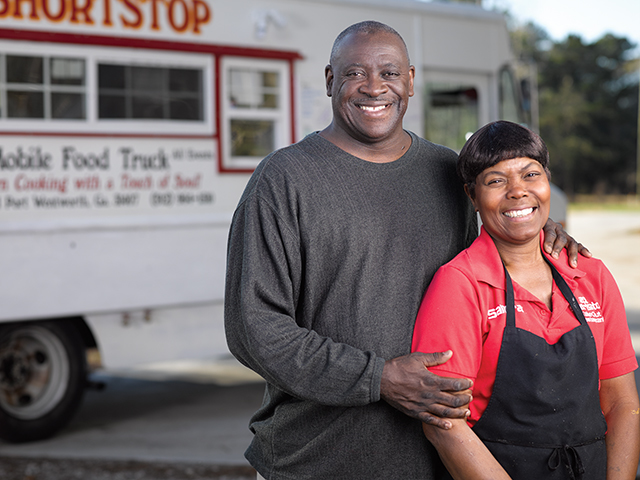 Business owners in front of food truck