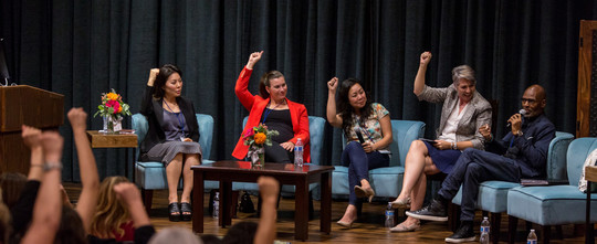 Photo: Business women in interview setting seated on a couch.