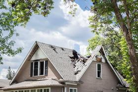 Photo of tornado damage to a home