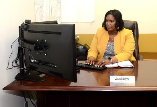 Karen Jenkins, Owner of KRJ Consulting, at her desk