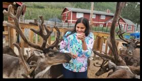 Prianka Sharma feeds reindeer at Alaska reindeer farm