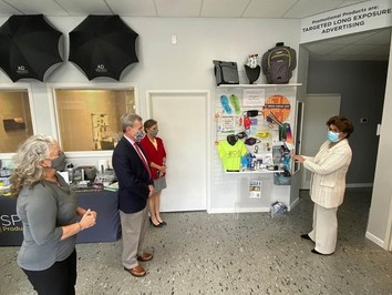 Administrator Carranza tours Ad Specialty Services, owned by founder and president Diana Morrison (left),