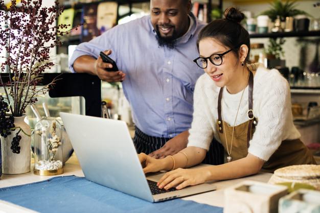 Small Business Owners with Laptop