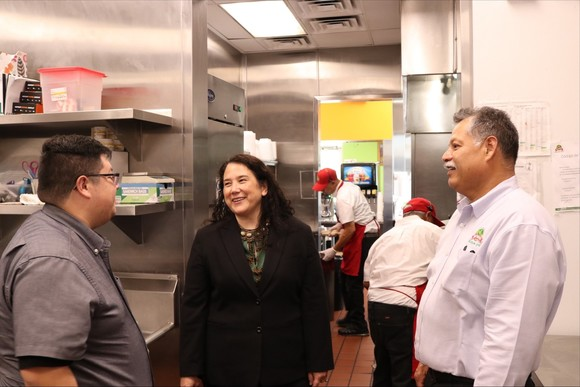 Photo of Administrator Guzman with employees at Don Tortaco