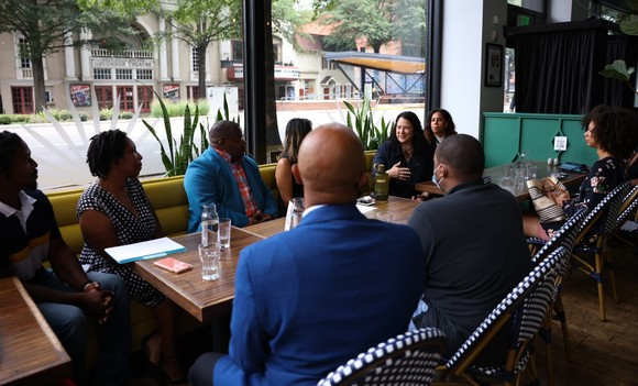 Photo of the SBA Administrator at a table with small business owners and leaders from the Richmond community