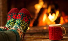 feet by a fire
