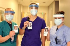 VA staff with masks and photo id badges