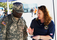 VBA Outreach interacts with active duty service member at Richmond NASCAR event