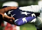 Survivors' Pension; folded American flag handed to survivor