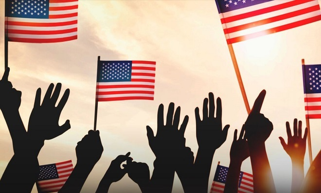 Hands holding U.S. flags