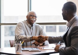 Senior Veteran meeting with a financial adviser