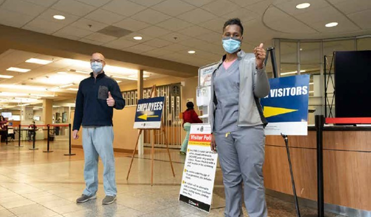VA employees wearing protective masks