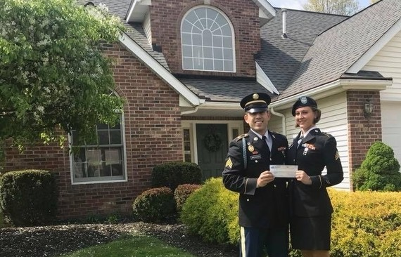 Veteran couple in front of their new home