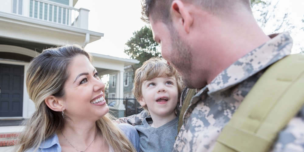 Military family smiling at each other