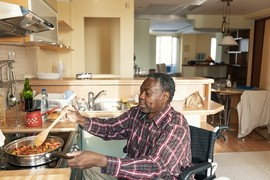 Disabled Veteran cooking in his specially adapted home