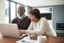 Veteran couple managing their VA pension online