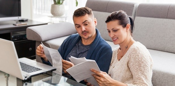 Veteran couple reviewing their tax forms