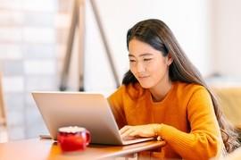 Veteran using GI Bill Comparison Tool on her laptop