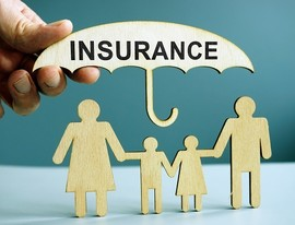 Life insurance concept of a family protected by umbrella