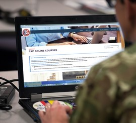 Transitioning service member takes a Transition Assistance Program course on laptop