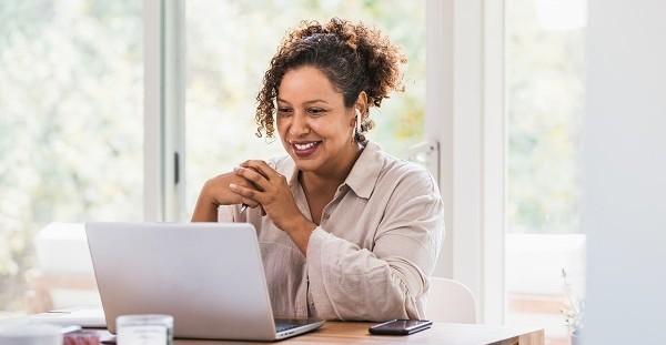 Veteran watching a webinar on her laptop