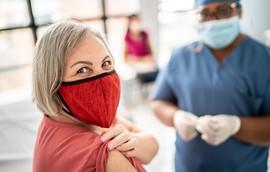 Woman showing arm before taking vaccine