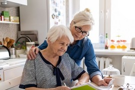 Senior Veteran and her fiduciary review a bill