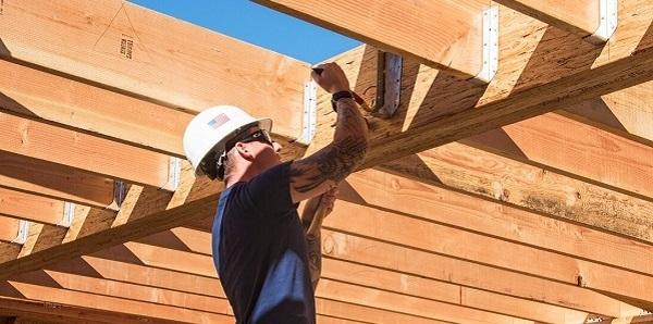 Volunteers helping with Veteran's home repairs