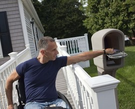 Disabled Veteran in a wheelchair gets his mail