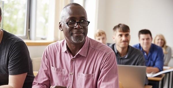 Veteran using tablet in class