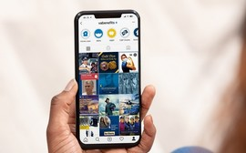 Veteran looks at VBA's Instagram on his smartphone