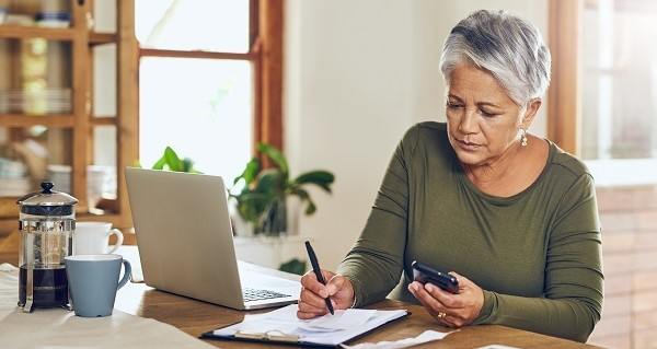 Surviving spouse working on her monthly budget