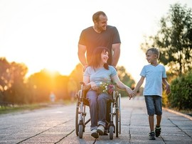 Disabled Veteran with her husband and son
