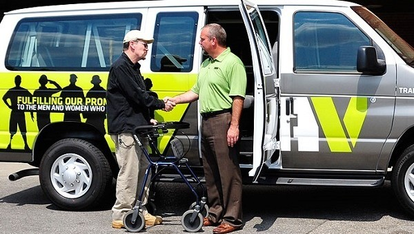 DAV National Adjutant greeting a Veteran as he leaves a VA medical center