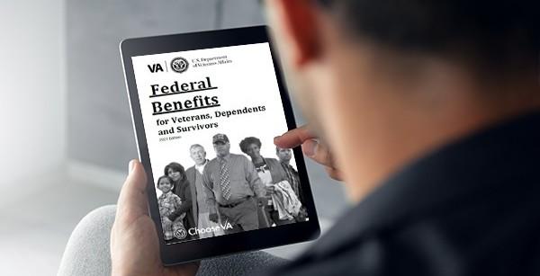 Veteran reading the 2021 Federal Benefits Handbook for Veterans, Dependents and Survivors