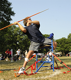 Photograph of Jimmy Green preparing to throw a javelin during the wheelchair games