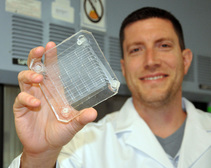 Dr. Joseph Potkay holding an artificial lung