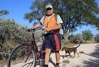 Veteran biking outdoors with his dog