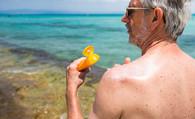 Veteran applying sun lotion at beach